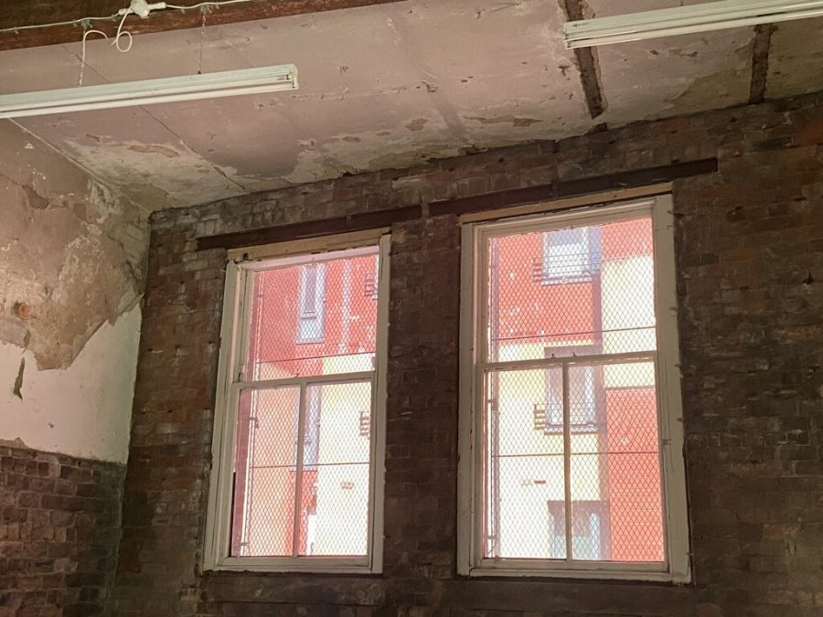 Photograph of windows opening out onto red walls.